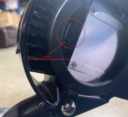 Press this bracket to release battery on the Air Hawk heavy duty motorised wheelchair