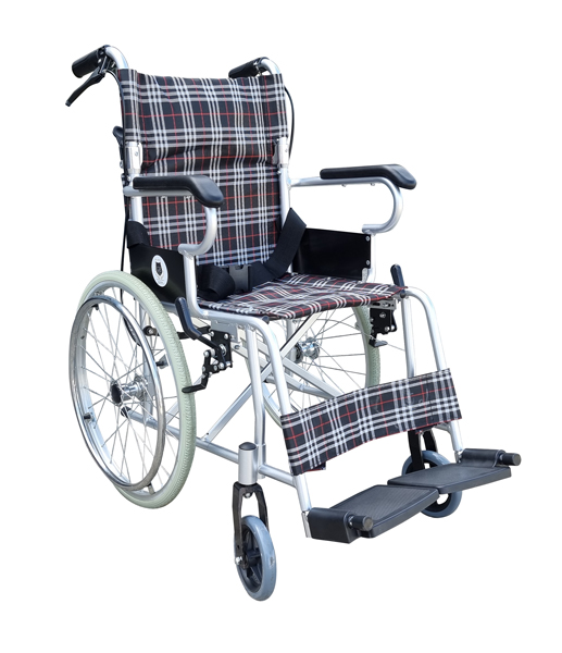 Compact self propelled Manual wheelchair with carer hand brake